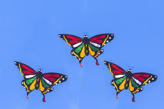 Colorful Kite Flying in Blue Sky Stock Image