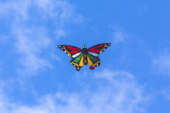 Colorful Kite Flying in Blue Sky Royalty Free Stock Photography