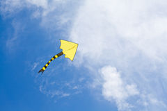 Colorful kite flying in the cloudy sky. copy space Royalty Free Stock Photography