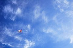 Colorful kite flying high in the sky stock photography