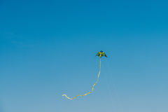 Colorful Kite Flying On Summer Blue Sky. Colorful Kite Flying In Summer Blue Sky Stock Image
