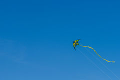 Colorful Kite Flying On Summer Blue Sky. Colorful Kite Flying In Summer Blue Sky Royalty Free Stock Images