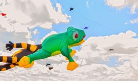 Colorful kite free to fly in the clear sky,. A beautiful summer day royalty free stock photos