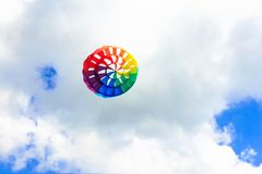 Colorful kite free to fly in the clear sky,. A beautiful summer day royalty free stock photo