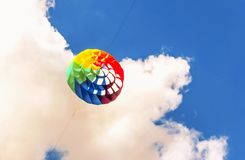 Colorful kite free to fly in the clear sky,. A beautiful summer day stock photo