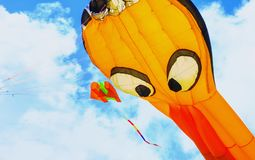 Colorful kite free to fly in the clear sky,. A beautiful summer day stock images