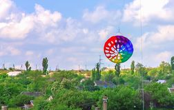 Colorful kite free to fly in the clear sky,. A beautiful summer day stock photography