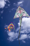 Colorful kite in the sky. Baby Game, set of colored kites flying in the cloudy sky Stock Images
