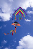 Colorful kite in the sky. Baby Game, set of colored kites flying in the cloudy sky Stock Photo