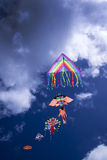 Colorful kite in the sky. Baby Game, set of colored kites flying in the cloudy sky Stock Image