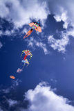 Colorful kite in the sky. Baby Game, set of colored kites flying in the cloudy sky Royalty Free Stock Photos