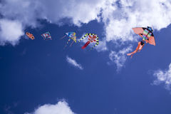 Colorful kite in the sky. Baby Game, set of colored kites flying in the cloudy sky Stock Photography