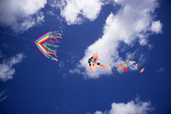 Colorful kite in the sky. Baby Game, set of colored kites flying in the cloudy sky Stock Photos