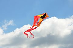 Colorful kite in sky. With white clouds Royalty Free Stock Image
