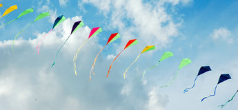 Colorful kites. In cloudy sky stock photo