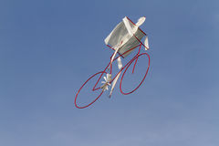 Colorful kites bicycle flying in the sky Royalty Free Stock Image