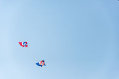 Colorful kites on blue sky. Colorful kites flying in blue sky Stock Image