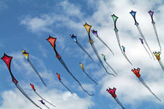 Colorful Kites in a Cloudy Summer Sky Stock Photo