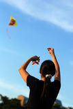 Colorful kites flying. In the blue skies Stock Images