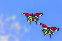 Colorful Kites Flying in Blue Sky Royalty Free Stock Photography