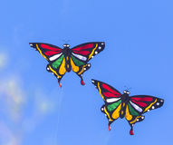 Colorful Kites Flying in Blue Sky Stock Images