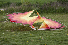 Colorful kites on the lawn Royalty Free Stock Photo