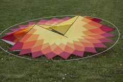 Colorful kites on the lawn Royalty Free Stock Image