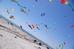 Colorful kites over beach. Angled view of colorful kites flying in blue sky over Semaphore beach, Adelaide International Kite Festival, 22 March 2008, South Stock Photography