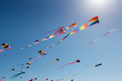 Colorful kites with sun flare Royalty Free Stock Photos