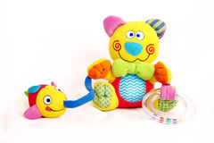 Colorful Kitten Baby Toy. Colorful development baby toy  on white background. Kitten holding a fish and a rattle Stock Images