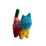 Colorful kitten. Wooden figurine of the kitten. Different colors Royalty Free Stock Photos