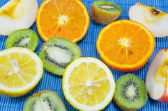 Colorful kiwis, lemons and oranges on a table. Colorful wallpaper of various fruits stock photography