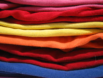 Colorful knits. Stack of colorful T-shirts stock photo