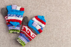 Colorful knitted convertible fingerless gloves. Colorful hand knitted convertible fingerless winter gloves with a fold back cap to cover the tips of the fingers Royalty Free Stock Images