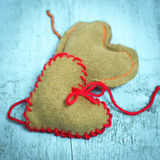 Colorful knitted hearts on the light blue boards. Valentine`s Day. Colorful knitted hearts. Valentines day. Heart pendant. Red heart. Valentine cards. Space for Stock Image