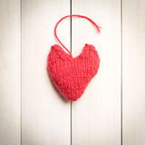 Colorful knitted hearts on light, wooden boards. Valentine`s Day. Colorful knitted hearts. Valentines day. Heart pendant. Red heart. Handmade Hearts. Valentine Royalty Free Stock Photography