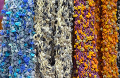 Colorful knitted scarves on display Stock Photos
