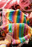 Colorful knitted wares at a country market Royalty Free Stock Photography