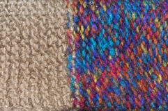 Colorful knitted wool. Background from colorful wool knitted into a pattern Royalty Free Stock Images