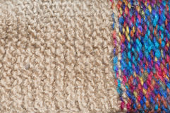 Colorful knitted wool. Background from colorful wool knitted into a pattern Royalty Free Stock Image