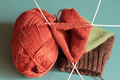 Colorful knitting. Color knitting on blue  background Royalty Free Stock Images