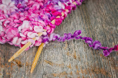 Colorful knitting on rustic background Royalty Free Stock Photos
