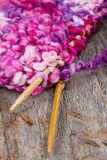 Colorful knitting and wooden needles Royalty Free Stock Photos