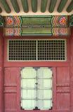 Colorful korean pattern above green door Stock Images