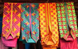 Colorful kurta mens shirt at a market, India Stock Image
