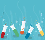 Colorful laboratory filled with a clear liquid and blue background Royalty Free Stock Images
