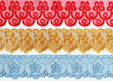 Colorful Lace Fabric. On white background Stock Photo