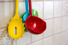 Colorful ladles hanging on a wall Royalty Free Stock Image