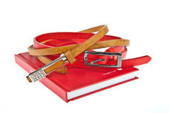 Colorful lady fashion belt and red cover book Royalty Free Stock Photo