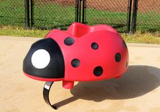 Colorful Ladybug Bouncy Toy on Childrens Playground Stock Image